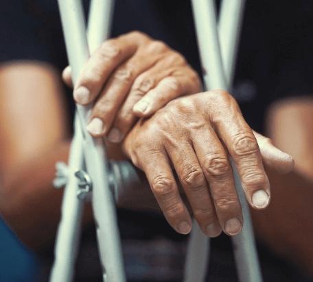 crutches-hands-injured-man