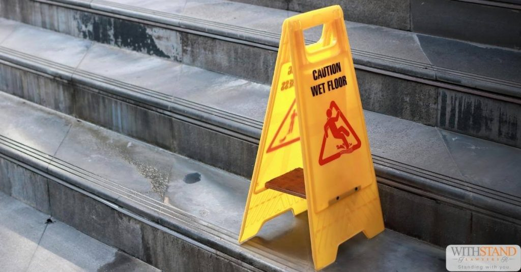 yellow caution sign stairs