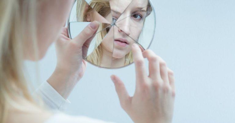 borken mirror woman